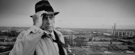 President of New York's World Fair Corp., Robert Moses, at World's fair site on heliport roof, surveying unfinished construction at site. (Photo by Dan Mccoy//Time Life Pictures/Getty Images)